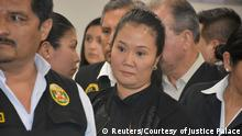 Opposition leader Keiko Fujimori is escorted by police officers after the judge ordered her back to jail pending a trial over allegations she used her conservative party to launder money for Brazilian construction company Odebrecht in Lima, Peru October 31, 2018. Courtesy of Justice Palace/ Handout via REUTERS ATTENTION EDITORS - THIS IMAGE WAS PROVIDED BY A THIRD PARTY.