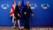 President of the European Commission Jean-Claude Juncker (R) and Britain's Prime Minister Theresa May leave after posing for photographers upon her arrival at the European Commission in Brussels on October 17, 2018. - British Prime Minister Theresa May is due to address a summit of European Union leaders in which Brexit negotiations are expected to be top of the agenda. (Photo by JOHN THYS / AFP) (Photo credit should read JOHN THYS/AFP/Getty Images)