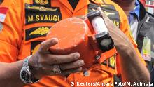 Chief of National Search and Rescue Agency Muhammad Syaugi shows a part of the black box of Lion Air's flight JT610 airplane, on Baruna Jaya ship, in the north sea of Karawang, Indonesia, November 1, 2018. Antara Foto/Muhammad Adimaja via REUTERS ATTENTION EDITORS - THIS IMAGE WAS PROVIDED BY A THIRD PARTY. MANDATORY CREDIT. INDONESIA OUT.