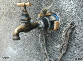 A water tap in a concrete wall