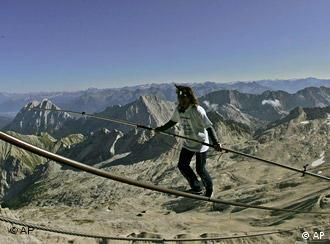 Swiss tightrope walker Freddy Nock balances on the 995-meter-long cable of the cable railway on top of the Zugspitz mountain, Germany's highest peak, Aug. 30, 2009