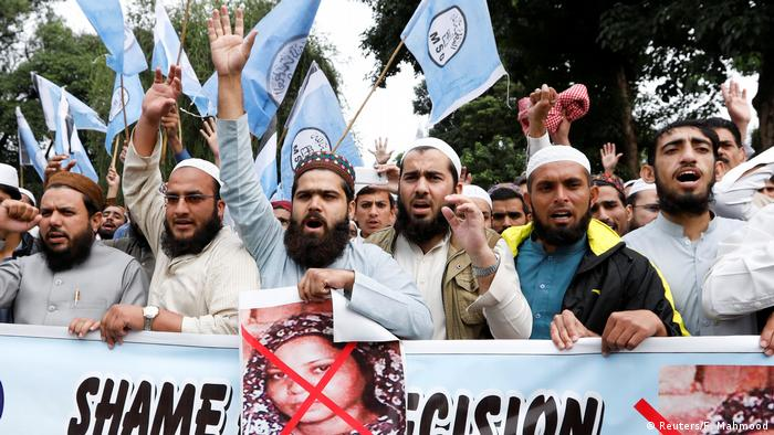 Supporters of the Tehreek-e-Labaik Pakistan (TLP), a hardline religious political party, chant slogans during a protest on the blocked Faizabad bridge