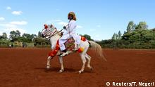 A man wearing traditional Oromo costume rides a horse during an Oromo Liberation Front (OLF) rally in the town of Woliso, Oromia region, Ethiopia, October 21, 2018. REUTERS/Tiksa Negeri SEARCH ETHIOPIA OROMOS FOR THIS STORY. SEARCH WIDER IMAGE FOR ALL STORIES.