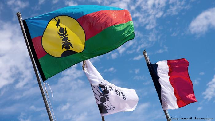 The Kanak and French flags fly in New Caledonia