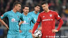 03.11.2018+++München, Deutschland++ Soccer Football - Bundesliga - Bayern Munich v Freiburg - Allianz Arena, Munich, Germany - November 3, 2018 Bayern Munich's Robert Lewandowski as he waits for a VAR decision on a penalty REUTERS/Andreas Gebert DFL regulations prohibit any use of photographs as image sequences and/or quasi-video