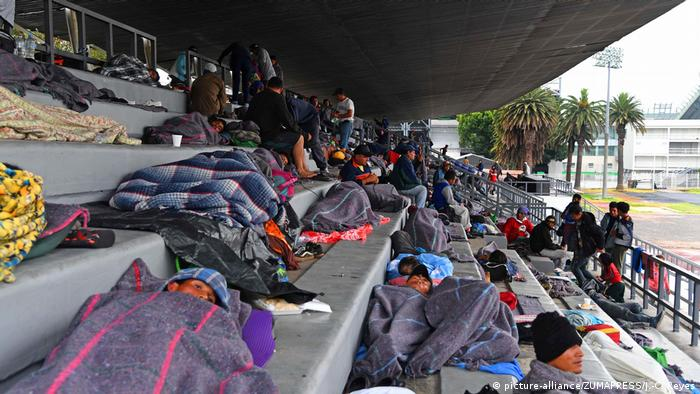 Migrants rest at the Jesus Martinez stadium in Mexico City