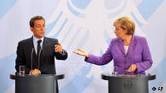 German Chancellor Angela Merkel and French President Nicolas Srakozy speaking at a press conference