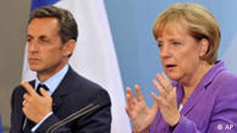 French President Nicolas Sarkozy and German Chancellor Angela Merkel