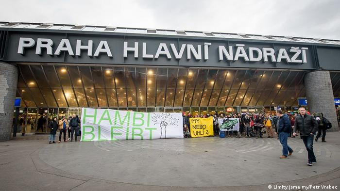 A group of environmentalists protest outside the main train station in Prague in support of Hambach Forest