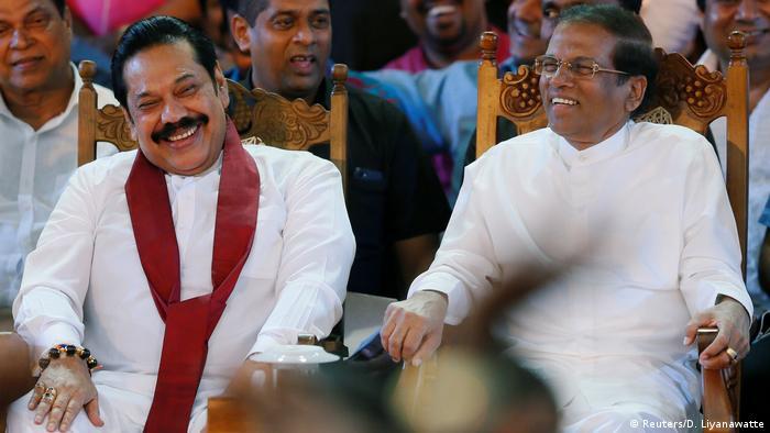 Ex-strongman Mahinda Rajapaksa (L) and current President Maithripala Sirisena at a rally