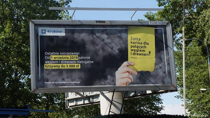 A billboard shows a campaign against air pollution in Krakow, Poland