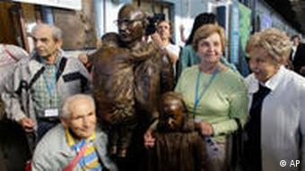 Some of the children saved by Nicholas Winton pose next to the newly unveiled statue of him at the main train station in Prague, Czech Republic on Tuesday, September 1, 2009