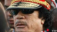 Libyan leader Moammar Gadhafi arrives for a military parade in Green Square, Tripoli, Libya, Tuesday, Sept. 1, 2009. Libyans are celebrating Tuesday the 40th anniversary of the 1969 military coup that brought leader Moammar Gadhafi to power. (AP Photo/Ben Curtis)