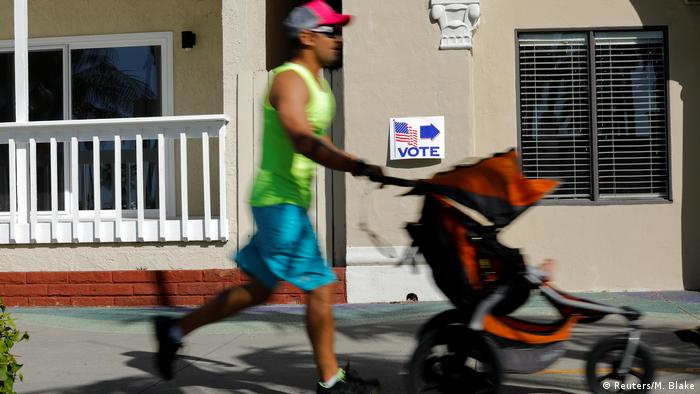 Heading towards the polling station along the boardwalk in Newport Beach, California (Reuters/M. Blake)