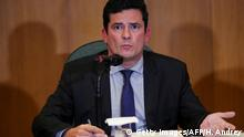 06.11.2018 Brazilian Federal Judge Sergio Moro, incoming Brazilian Justice and Public Security Minister, gestures during a press conference at the Federal Justice Court in Curitiba, Brazil on November 06, 2018. (Photo by Heuler Andrey / AFP) (Photo credit should read HEULER ANDREY/AFP/Getty Images)