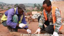 (171120) -- KAMPALA, Nov. 20, 2017 () -- A Chinese worker (R) works closely with an Ugandan worker at the construction site of the Entebbe-Kampala Expressway Project at an area along the Entebbe Express highway in Uganda, Nov. 17, 2017. The Entebbe-Kampala Expressway, which is under construction by China Communications Construction Company Ltd (CCCC), is a 350 million U.S. dollar project linking Uganda's capital Kampala to Entebbe International Airport. (/Zhang Gaiping) (zf) |