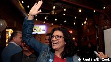Democratic U.S. congressional candidate Rashida Tlaib reacts after appearing at her midterm election night party in Detroit, Michigan, U.S. November 6, 2018. REUTERS/Rebecca Cook