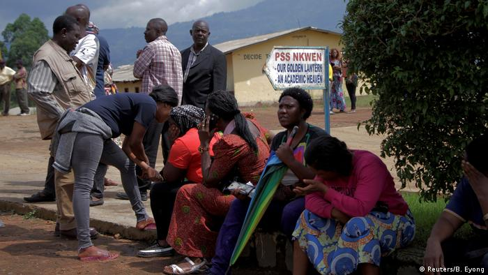 A group of people waiting for news of the kidnapped children