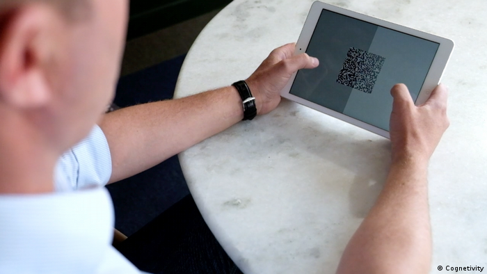 Man taking Cognetivity's Integrated Cognitive Assessment (ICA) on an iPad to test cognitive performance (Cognetivity)
