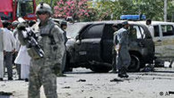 Police guard a mosque in eastern Afghanistan attacked by a suicide bomber on Wednesday