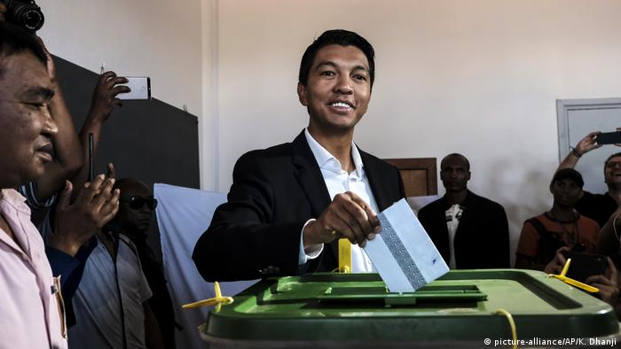 Andry Rajoelina puts a ballot in the box