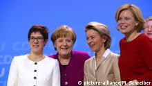 General secretary Annegret Kramp-Karrenbauer, German Chancellor and party chairwoman Angela Merkel, designated defense minister Ursula von der Leyen and designated agriculture minister Julia Kloeckner, from left, smile at the party convention of the Christian Democratic Union CDU in Berlin, Germany, Monday, Feb. 26, 2018. The delegates voted for the coalition agreement on forming a new German government. (AP Photo/Markus Schreiber)