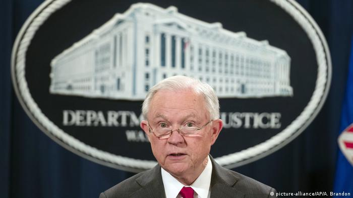 Attorney General Jeff Sessions pauses before speaking during a news conference at the Department of Justice in Washington.
