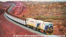 epa03382920 A handout image dated 10 June 2008 and made available by Australian Fortescue Metals Group Ltd showing a Fortescue train at an undisclosed location in Australia. Fortescue Metals Group, Australia's third-largest iron ore miner, said 04 September 2012 that it had shelved a 1.6-billion-US-dollar expansion of its mines in western Australia because of a minerals price slump. Its announcement was the latest delayed investment for an Australian miner linked to the falling price of commodities as demand wanes, particularly in China. Fortescue, which lifted shipments of iron ore to China and other big buyers by 41 per cent in the year to June, said capital outlays in the current year would fall to 4.6 billion dollars from the 6.2 billion dollars it flagged just weeks ago. EPA/FORTESCUE METALS GROUP LTD / HANDOUT HANDOUT EDITORIAL USE ONLY/NO SALES +++(c) dpa - Bildfunk+++ |
