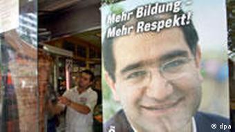 Wahlplakat des türkisch-stämmigen Özcan Mutlu