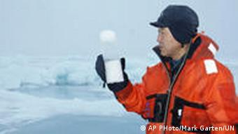 Ban examines an ice-core he pulled from the polar ice with scientists in Norway on Sept. 1, 2009.
