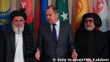 Russian Foreign Minister Sergei Lavrov and representatives of both the Afghan government and the Taliban pose for a photo prior to international talks on Afghanistan in Moscow on November 9, 2018. (Photo by Yuri KADOBNOV / AFP) (Photo credit should read YURI KADOBNOV/AFP/Getty Images)