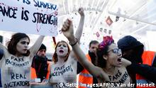 Members of feminist movement Femen demonstrate in front of the Arc de Triomphe on November 10, 2018, as several leaders are to arrive in Paris on the eve of the commemorations of WWI armistice centenary. (Photo by Geoffroy VAN DER HASSELT / AFP) (Photo credit should read GEOFFROY VAN DER HASSELT/AFP/Getty Images)