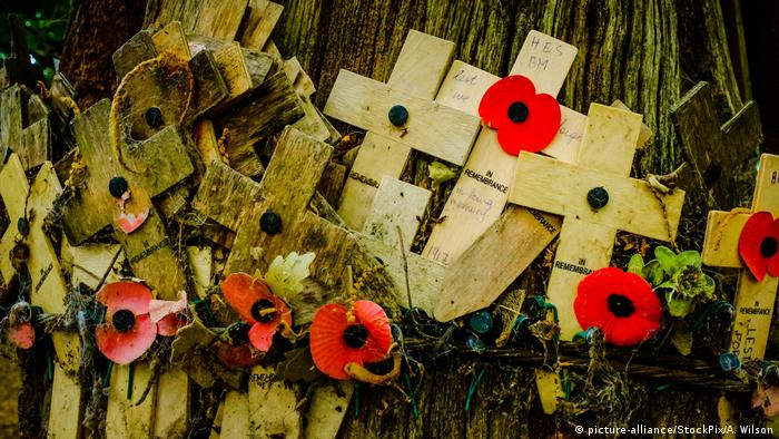 Remembrance crosses attached to a tree in Sanctuary Wood Near Passchendaele