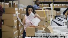 09.11.2018 A Broward County Supervisor of Elections worker looks at a ballot during a canvasing board meeting Friday, Nov. 9, 2018, in Lauderhill, Fla. Florida is once again at the center of election controversy, but this year there are no hanging chads or butterfly ballots like in 2000. And no angry mobs in suits — at least not yet. (AP Photo/Joe Skipper) |