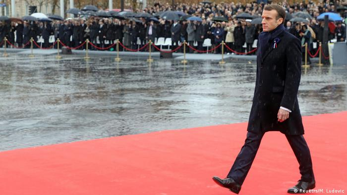 Macron walking on red carpet before his speech (Reuetrs/M. Ludovic)