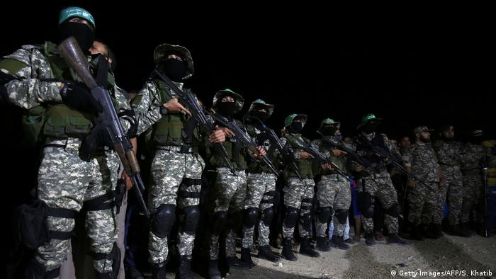 Fighters from the Ezzedine al-Qassam Brigades, the armed wing of the Palestinian Hamas movement, attend a memorial service for the leader of the brigade Ibrahim Abu Al-Naja in Rafah in the southern Gaza Strip on June 10, 2017, after he was killed in an accidental explosion earlier in the month. (Getty Images/AFP/S. Khatib)