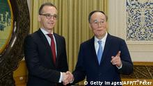 Außenminister Heiko Maas in China | Wang Qishan (Getty Images/AFP/T. Peter)