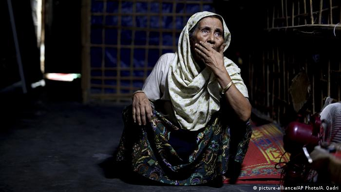 An elderly Rohingya refugee sits in a shelter at a refugee camp in Bangladesh