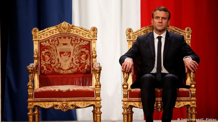 Emmanuel Macron sitting on a red golden chair (Getty Images/C. Platiau)