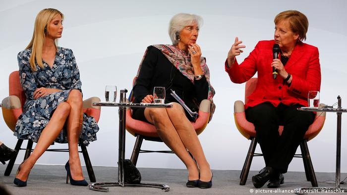 Christine Lagarde (center), with Ivanka Trump and Angela Merkel
