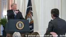 November 7, 2018 - Washington, District of Columbia, U.S. - United States President Donald J. Trump responds to a question from CNN White House correspondent Jim Acosta as he holds a press conference in the East Room of the White House in Washington, DC on Wednesday, November 7, 2018 |
