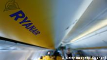A picture shows Ryanair logo as passsengers board inside a Ryanair plane at Carcassonne Airport in Carcassonne, southern France on September 27, 2018. - Ryanair will cut 150 flights because of strike action across Europe, as Brussels urged it to respect workers' rights enshrined in EU law. (Photo by Emmanuel DUNAND / AFP) (Photo credit should read EMMANUEL DUNAND/AFP/Getty Images)