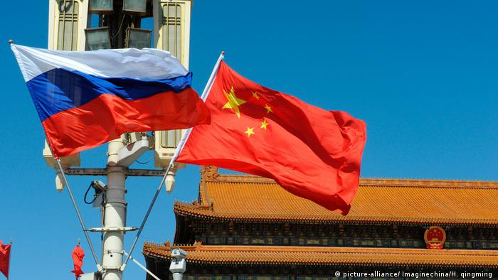 Russian and Chinese flags in Beijing