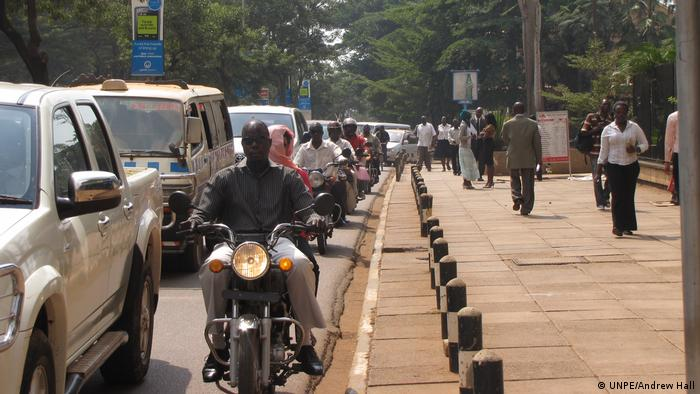 A busy street in Nairobi, Kenya, filled with cars and motorcycles