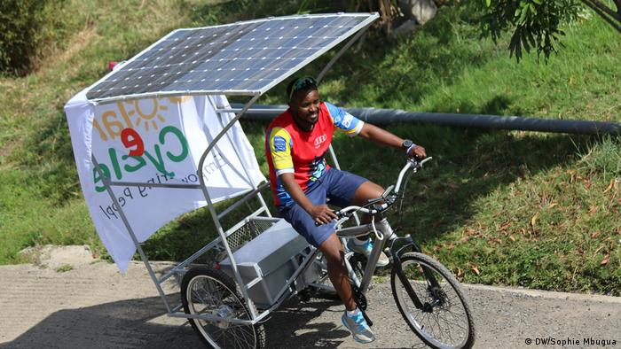 A rider tests a solar three-wheeler at Strathmore University
