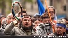 October 12, 2015. Mapuches, Chile's largest indigenous group, participate in a protest rally in Santiago on October 12, 2015. Hundreds of Chileans natives and members of social organizations marched today demanding the restitution of their ancestral lands on the day commemorating the 523nd anniversary of Christopher Columbus' arrival to America. AFP PHOTO/CHRISTIAN MIRANDA (Photo credit should read CHRISTIAN MIRANDA/AFP/Getty Images)