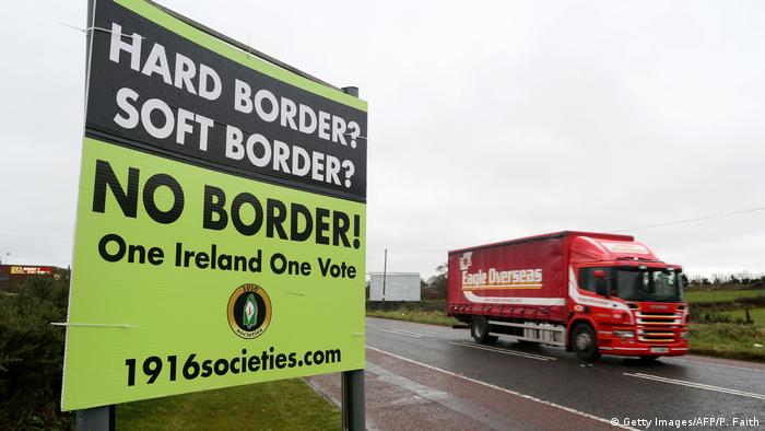 A lorry passes a sign calling for no border near Newry (Getty Images/AFP/P. Faith)