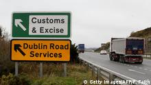 A lorry passes a sign on a main road outside Newry, Northern Ireland, on November 14, 2018 pointing towards an old customs and excise station near the border between Northern Ireland and Ireland. - British Prime Minister Theresa May defended her anguished divorce deal with the European Union before rowdy lawmakers on Wednesday before trying to win the backing of her splintered cabinet with the so-called Irish backstop arrangement to guard against the imposition of a hard border between Ireland and Northern Ireland one of the contentious issues, according to reports. (Photo by Paul FAITH / AFP) (Photo credit should read PAUL FAITH/AFP/Getty Images)