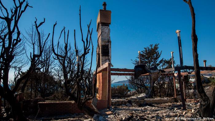 A burned-out house by the ocean in Malibu