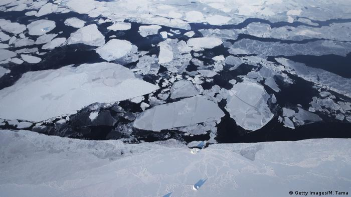 An aerial view of chunks of sea ice which have broken away from the Greenland ice sheet (Getty Images/M. Tama)